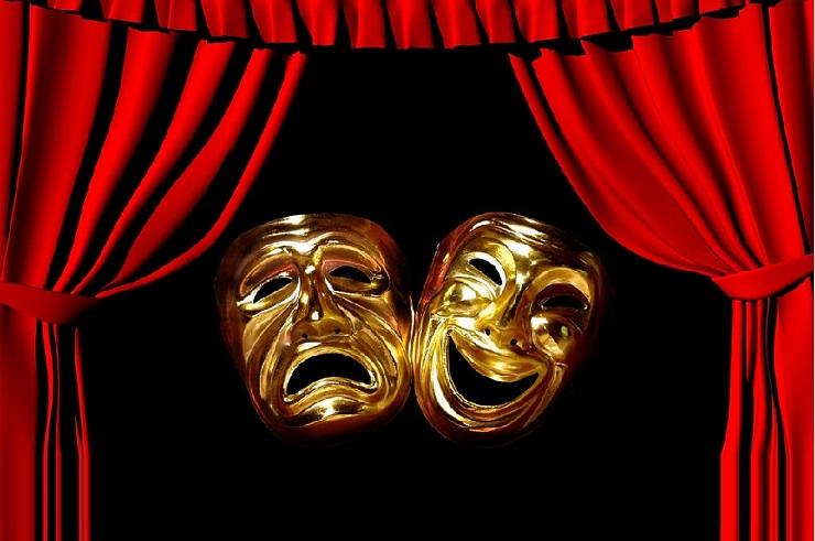 cortinas de teatro com duas máscaras representando às emoções triste e alegre
